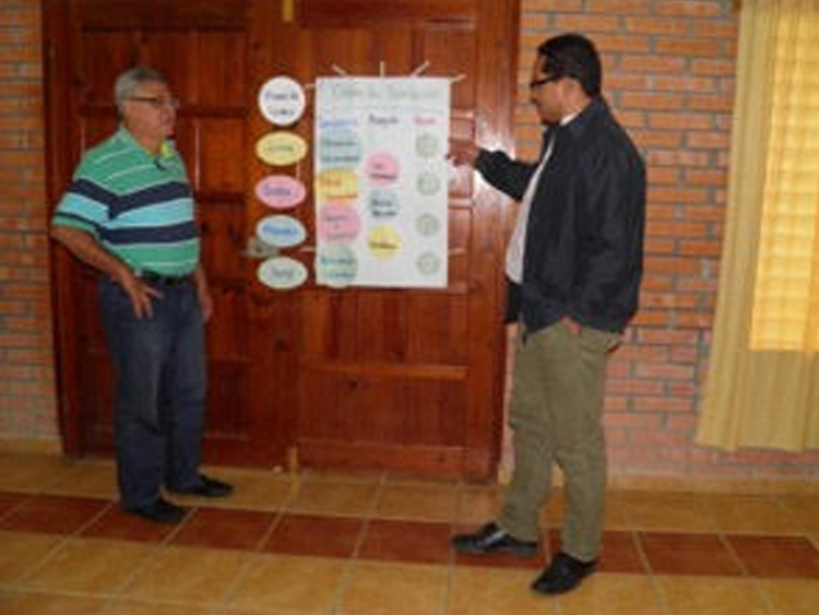 Roy Lara, left, with Edwin Escoto, right taking part in a Vecinos Honduras staff meeting.