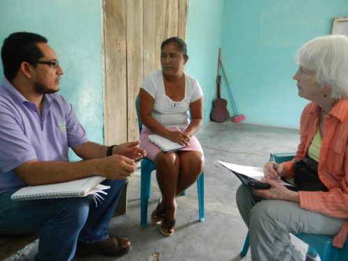 Edwin Escoto, Executive Director of Vecinos Honduras, and Mary Procter ask Mercedes Rios for her thoughts. A farmer, shopkeeper, and officer in a new rural bank, she is taking advantage of the VH-TCP program and is optimistic about the future.
