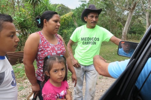 A family stops our truck to ask if it can participate in the VH-TCP program. Roy says yes and invites them to the next nearby meeting.