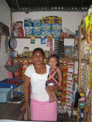 Mercedes Rios, shown in the small store she runs in her house, liked helping other families learn how to build wood-conserving stoves.