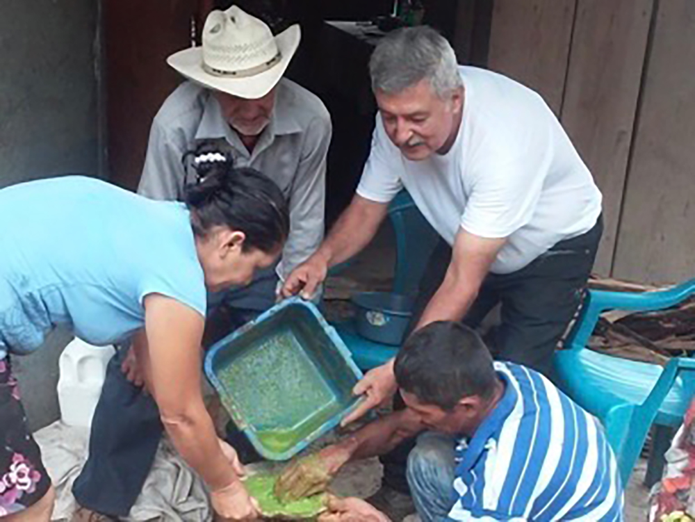 Roy and Agua Zarca in workshop to make herbicides and fertilizers.